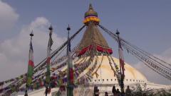 People walk around the Buddhist spiritual center Boudhanath Stupa,Nepal Stock Footage