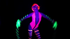 Ultra violet disco glow sexy gogo female dancer hulahoop Stock Footage