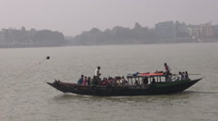Hoogly river in Kolkata and boats with prayers near Dakshineswar Kali temple Stock Footage