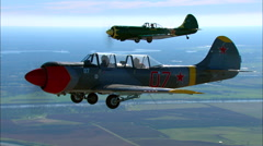 Yakovlev Yak 52 Yak 50 Air to Air Backlight Zoom Stock Footage
