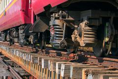 Lower view of trainst suspension on old wood railways bridge Stock Photos
