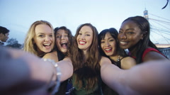 4K Attractive fun loving female friends pose to take a selfie at party - stock footage
