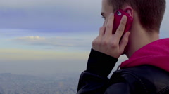 Man Talks On Phone At Scenic Overlook Of San Francisco Skyline Stock Footage