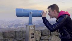 Man Uses Coin Operated Telescope To look At View Of San Francisco At Sunset Stock Footage
