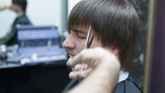 Hair stylist make male hair style Stock Footage