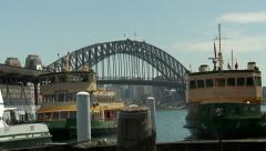 Sydney - Harbour Docked Ferries with Bridge In Background Slow Zoom Out Stock Footage