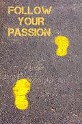 Stock Photo of Yellow footsteps on sidewalk towards Follow your Passion message