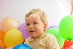 baby boy with colorful balloons - stock photo