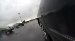 A car driving through parking lot at strip mall Stock Footage