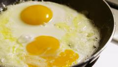Fried eggs preparation on a pan, time lapse Stock Footage
