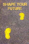 Yellow footsteps on sidewalk towards Shape your future message.Conceptual ima - stock photo