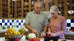 Senior couple cooking together in the kitchen Stock Footage