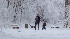 Man And Two Little Girls Playing In The Snow Family Concept Stock Footage