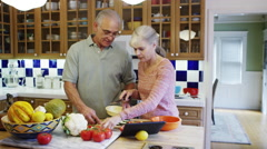 Senior couple cooking together Stock Footage