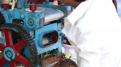 Make reed juice with special machine closeup Stock Footage