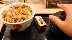 Tokyo beef rice bowl - person opens soup bowl lid Stock Footage
