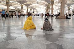 MEDINA, SAUDI ARABIA (KSA) - JAN 30: Two pilgrims woman sitting in the courty Stock Photos