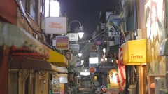 Many bars in the alley - night Shinjuku Golden Gai Stock Footage