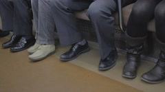 Closeup - shoes of people on Tokyo train Stock Footage