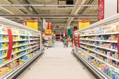 People Shopping In Supermarket Store Aisle - stock photo