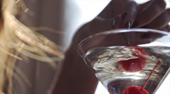Cherry in martini glass. cherry into cocktail Stock Footage