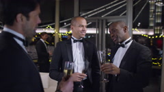 4K Male friends or business colleagues drinking &chatting at formal social event - stock footage