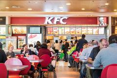 People Eating Fast-Food From KFC - stock photo