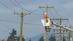 Hydro Lineman Uses Special Cutting Tool Stock Footage
