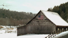 Rustic barn american flag snow Stock Footage