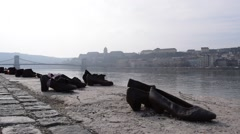 Shoes on the Danube Bank Memorial by the Danube River in Budapest, Hungary Stock Footage