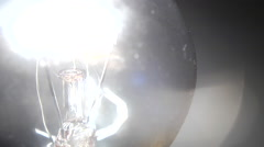 Detail of a real tungsten lamp turning on and turning off Stock Footage