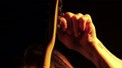Musician tunes a guitar during a concert Stock Footage
