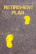 Yellow footsteps on sidewalk towards Retirement Plan message.Conceptual image - stock photo