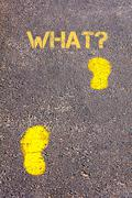 Yellow footsteps on sidewalk towards What message.Conceptual image Stock Photos