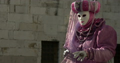 A typical venetian mask near a palace Stock Footage