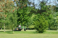lawnmover on a golf in Jouy Le Moutier - stock photo