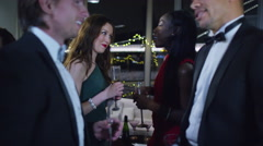 4K Cheerful male friends or business colleagues embrace at sophisticated party - stock footage
