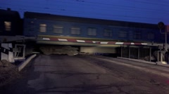 Night Drive through railway onhighway, there is train freight Stock Footage