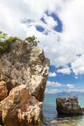Seascape of Adriatic Sea. Rocks in the foreground. Stock Photos