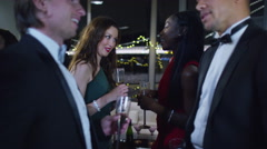Stock Video Footage of 4K Cheerful male friends or business colleagues embrace at sophisticated party