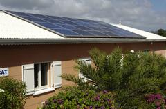 photovoltaic panels on a roof of a house in Martinique - stock photo