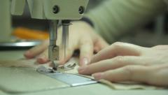 Closeup of a sewing machine. Tailoring, аpparel manufacturing - stock footage