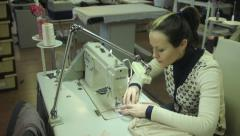 A woman works at a garment factory. Tailoring, аpparel manufacturing - stock footage