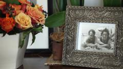 Picture Frame With old photo On Side Table Stock Footage