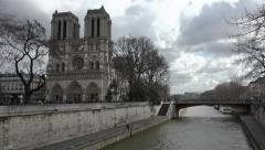 Notre Dame Cathedral with Seine river, Paris - pan movement Stock Footage