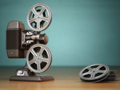 Video, cinema concept. Vintage film movie projector and reels on green backgr - stock illustration