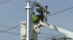 Traffic Control Technician Repairing Broken Light - stock footage
