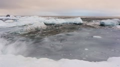 Waves on the freezing water in the Arctic fjord - Spitsbergen, Svalbard Stock Footage
