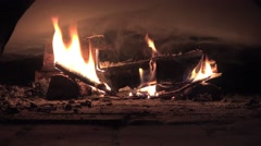 Hot fire in the fireplace on a black background, 4k Stock Footage
