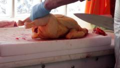 Stock Video Footage of Butcher Chopping a Chicken